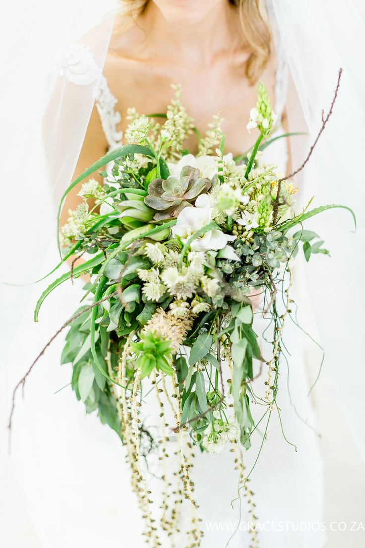 Gorgeous Beach inspired wedding bouquet with Palm Berries, twigs, Aloes, Pineapple plant. South african Luxury Beach Wedding Absolute Perfection:  drift wood, beach wedding decor, luxury south african beach wedding, palm berries   http://www.absoluteperfection.co.za/#!CHANTELLE-AND-RJS-ROMANTIC-INTIMATE-BEACH-WEDDING/c1jar/57ad8b610cf2d58e4d0423e6