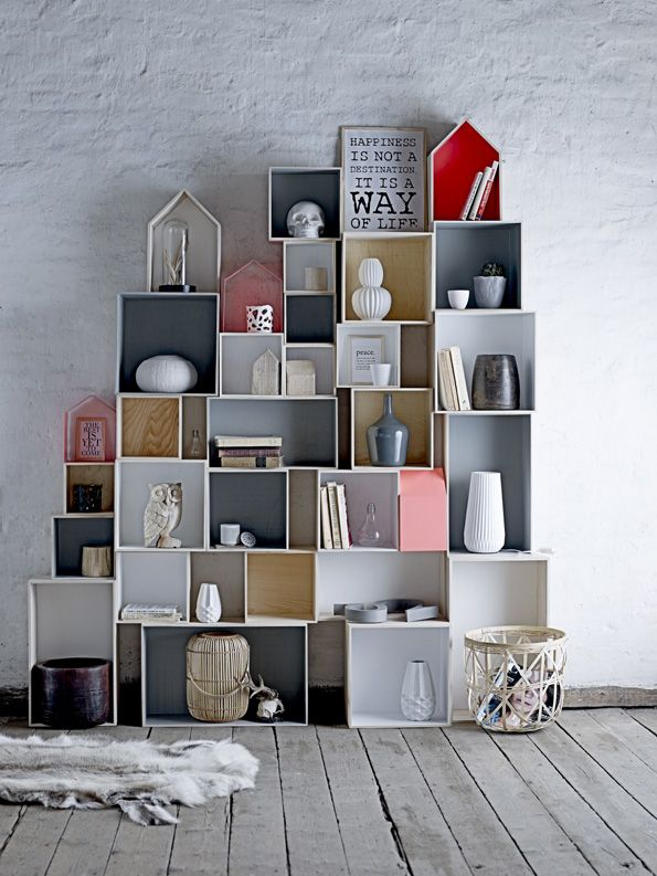 for a rustic look... get wooden boxes and rack them up together .. Can giv a black n white or a red and black or a metalic paint