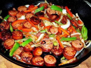 "Ingredients: 1 Polish sausage sliced into ½"" slices 1 red bell pepper, seeded and sliced 1 green bell pepper, seeded and sliced 1 white onion, sliced 1 tbsp olive oil 1 tbsp butter 1 tsp Worcesters..."