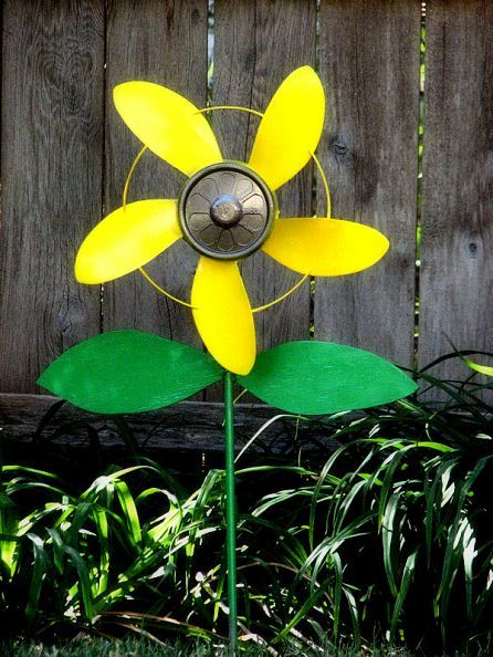 Sunflower pinwheel out of the plastic blade from a broken box fan, a bicycle pedal, a steel rod and scrap of plywood!