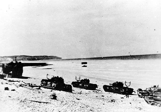 The Dieppe Raid - Damaged Churchill tanks of the Calgary Regiment on the main beach at Dieppe.