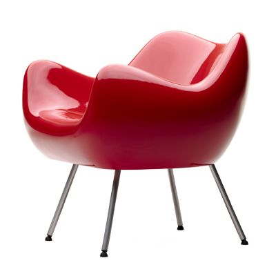 RM 58  This armchair, made of fibreglass, is one of the first seats made using this material, both in Poland and worldwide. Designed independently by Roman Modzelewski, it surprises not only by the innovative technology that was used, but also by the fully-enclosed organic form achieved in this material. Today is it produced using polyethylene, with rotational moulding technology, then varnished to a high gloss.