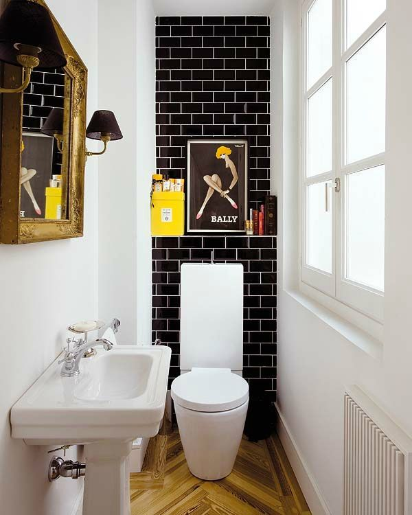 15 Incredible Small Bathroom Decorating Ideas - black subway tiles with white grout, chevron wooden floors, clean white walls + pops of yellow