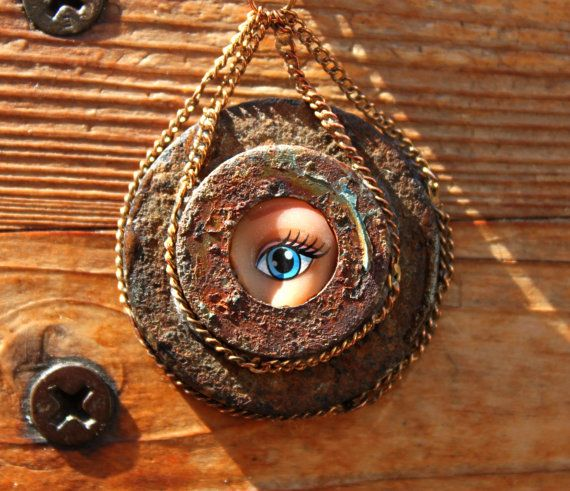 Barbie eye is authentic and has been repurposed (its eco friendly) which I think adds to the post apocalyptic beauty. Necklace is wear extremely