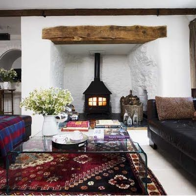 Love this alcove for the wood burning stove - I want to replicate a corner chimney fireplace with our pellet stove for the living room.