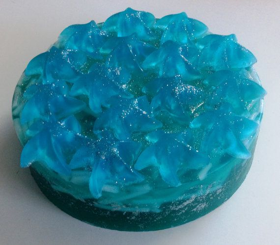 Artfully-designed aquamarine-blue - turquoise soap cake, made of high quality glycerin which leaves the skin feeling silky, moist, and smelling wonderful. Made to look like a bakery cake, while all decoration is real Soap! Ideal as Wedding Centerpiece decor for a by-the-beach wedding. Perfect for aromatic room decoration too when displays on a Cake dish!