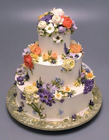 Stunning floral buttercream wedding cake by Cupcake Cafe in NYC.  weddingcake-cupcakecafe-white.jpg