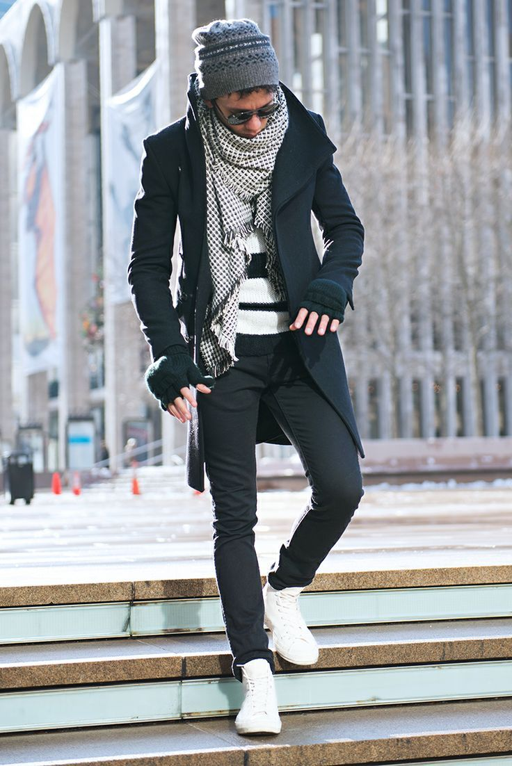 Go for a black overcoat and black chinos to create a smart casual look. Feeling brave? Complete your look with white high top sneakers.  Shop this look for $202:  http://lookastic.com/men/looks/beanie-sunglasses-scarf-crew-neck-sweater-gloves-overcoat-chinos-high-top-sneakers/6308  — Charcoal Print Beanie  — Black Sunglasses  — White and Black Polka Dot Cotton Scarf  — White and Black Horizontal Striped Crew-neck Sweater  — Black Wool Gloves  — Black Overcoat  — Black Chinos  — White High…