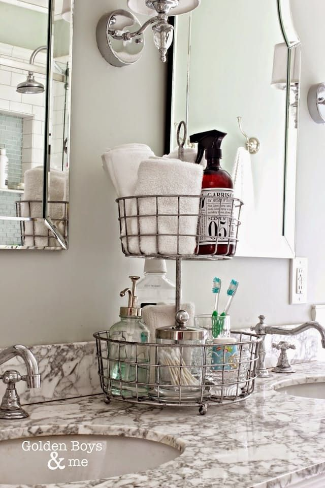 So, you're stuck in a tiny bathroom, and you don't even have a medicine cabinet for your toiletries to call home—now what? It may seem like you've got no potential for stylish and functional storage, but all hope is not lost. There are plenty of ways you can sneak in extra storage in a cabinet-less bathroom. If you need inspiration, here are some solutions and projects to try.
