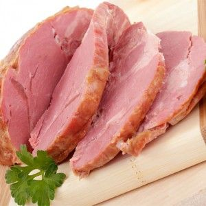 Ham joint - a wonderful economical option - boil it and save the stock for pea and ham soup, then roast and slice. Delicious with parsley sauce. And leeks.