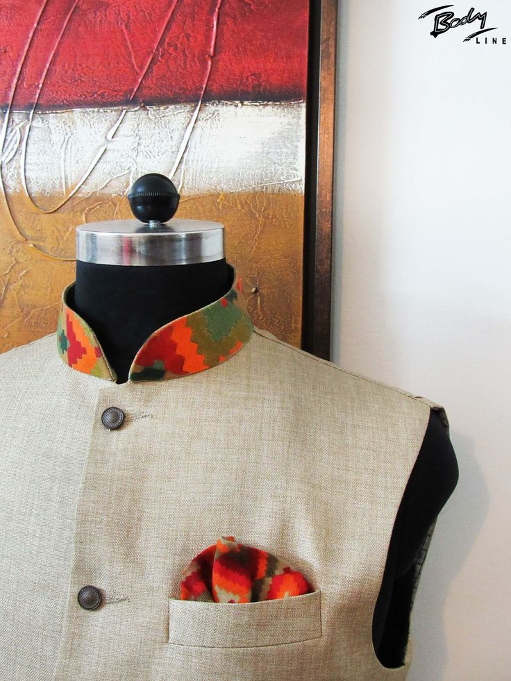 Made with jute, this nehru jacket has an interesting twist provided by an abstract handpainted collar.