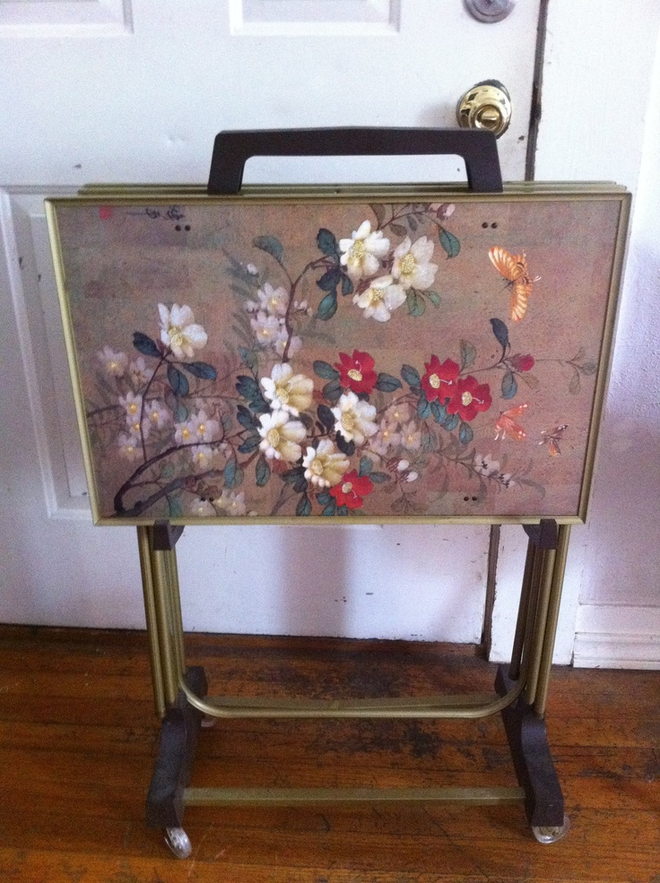 Vintage Mid Century Floral Asian Set Of 4 TV Trays Tables & Stand Cart. $149.99, via Etsy.