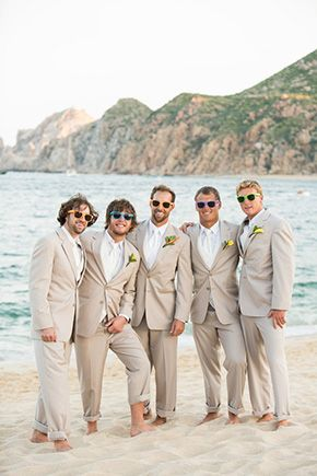 beach wedding suits with a pop of color on sunglasses. Photography by www.amybennettphoto.com