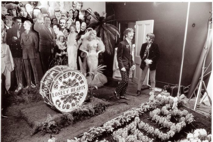 John Lennon, Ringo Starr and cardboard cut-outs during the making the cover for Sgt Pepper's Lonely Hearts Club Band