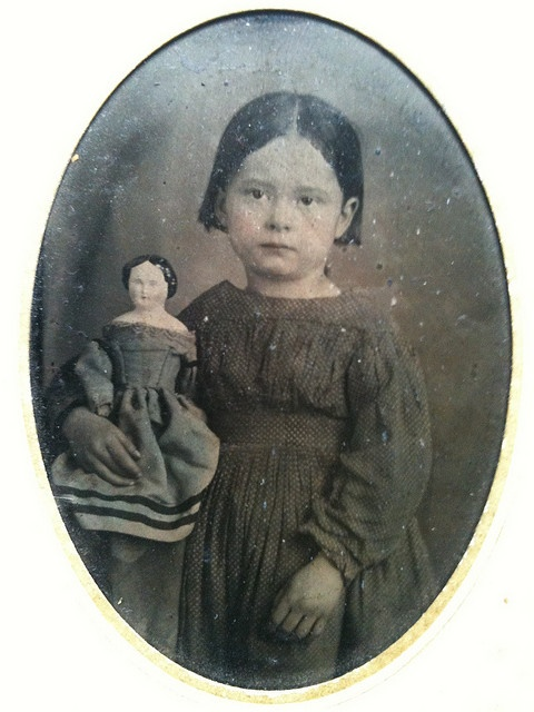 Girl with doll in blue dress tintype