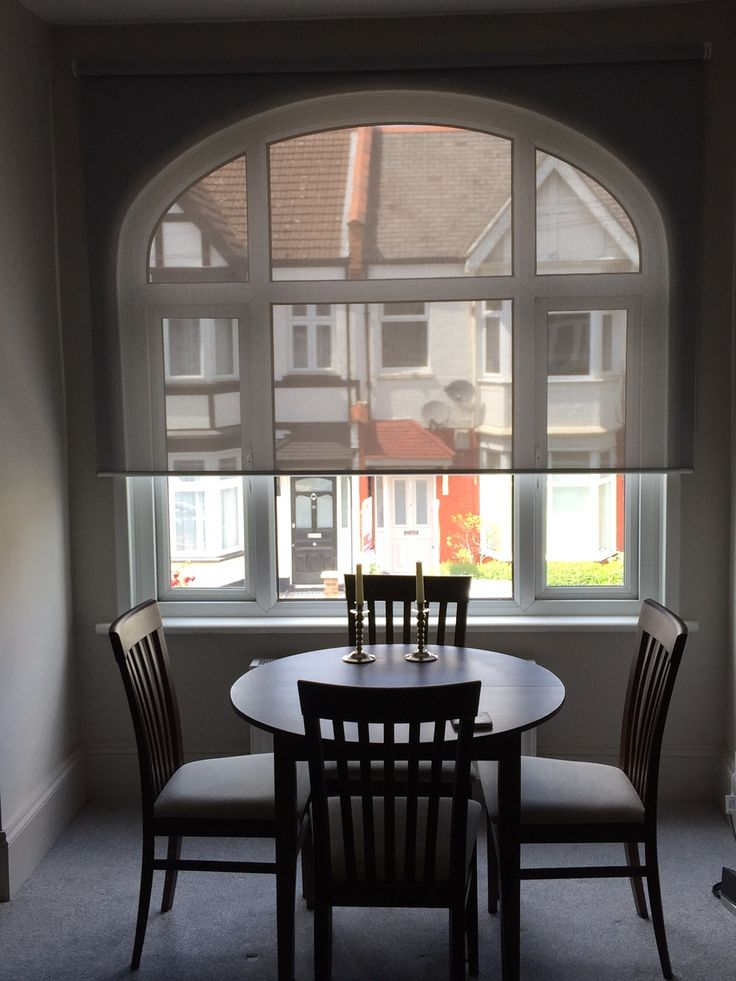 sunscreen roller blind to arched window for a dining room in tooting http - Dining Room Blinds
