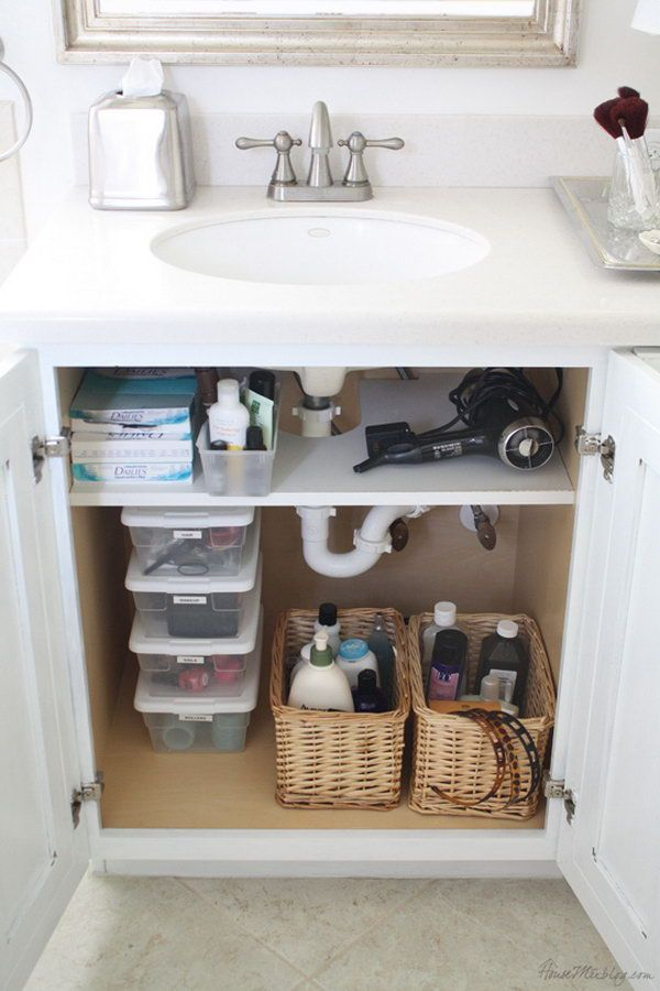Add a shelf that was cut out for pipes in the cabinet. Use storage space under a bathroom sink for extra toiletries. http://hative.com/creative-under-sink-storage-ideas/