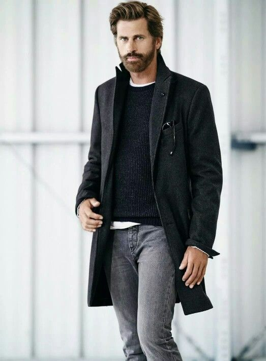 Try pairing a black overcoat with grey jeans for a seriously stylish look.  Shop this look for $131:  http://lookastic.com/men/looks/jeans-overcoat-crew-neck-sweater-sunglasses-crew-neck-t-shirt/5604  — Grey Jeans  — Black Overcoat  — Black Crew-neck Sweater  — Black Sunglasses  — White Crew-neck T-shirt