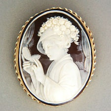 Hand Carved Shell Cameo Pendant/Brooch Of A Woman With A Hat And Flowers Mounted In A 14k Gold Frame