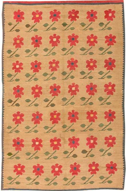 Size: 4 ft x 6 ft 8 in (1.22 m x 2.03 m)    Sale:   $3,600.00  Turkey, Circa 1900 - Lovely little peonies on stems repeat in rows across the deep tan ground of this charming antique Bessarabian kilim. Each of them leans gracefully to the left, imparting a gentle swaying rhythm to the overall design. Only a thin green band and zig-zag serve as a border to enclose or frame the composition, affirming th essential restraint and simplicity of the piece. J. Nazmiyal Inc | 31