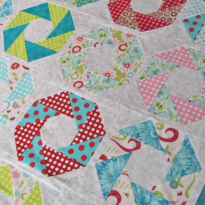 Patchwork quilt - sewing triangles into octagons.