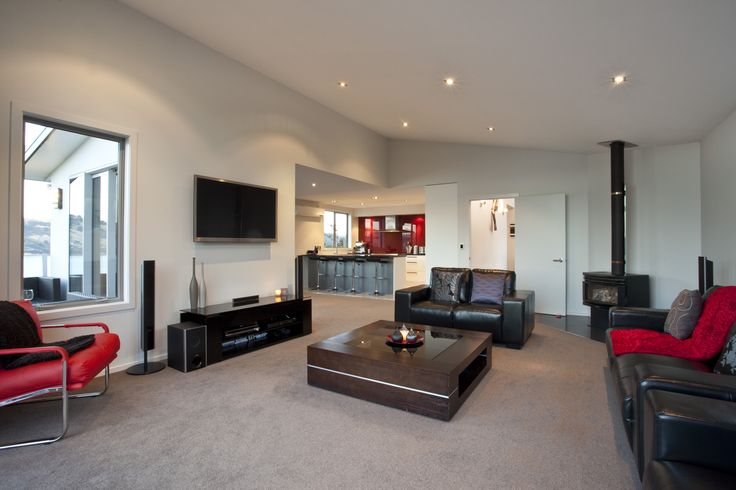 A fireplace for Dunedin living is more than welcome in this open plan living room.