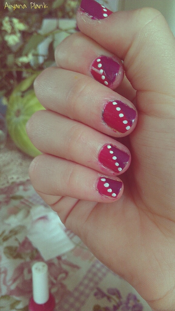 Easy nail design. Half of one shade, half of another, with dots in the middle