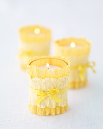 Personalizing Votive Candles    When having a destination wedding, it's a good idea to use decorations or supplies that pack easily, like paper and ribbon. Here, we layered strips of crepe paper with ribbon around plain votive candles. Alternatively, you can simply wind gold jewelry wire around the bare glass to dress them up.