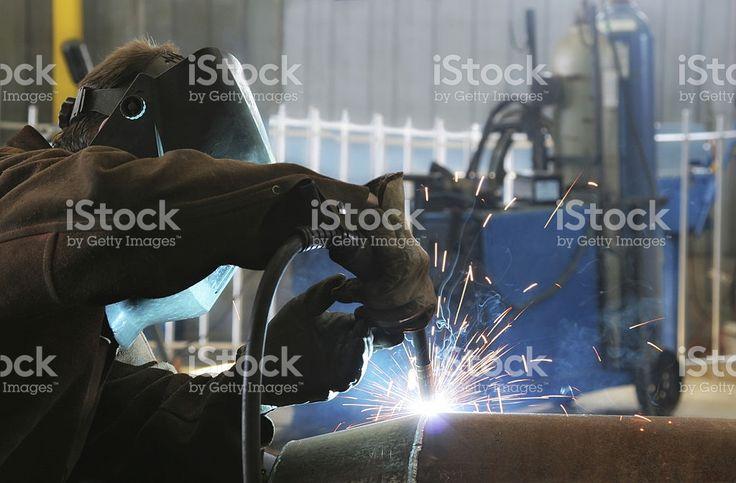 Welder Work inside an Industrial Building royalty-free stock photo