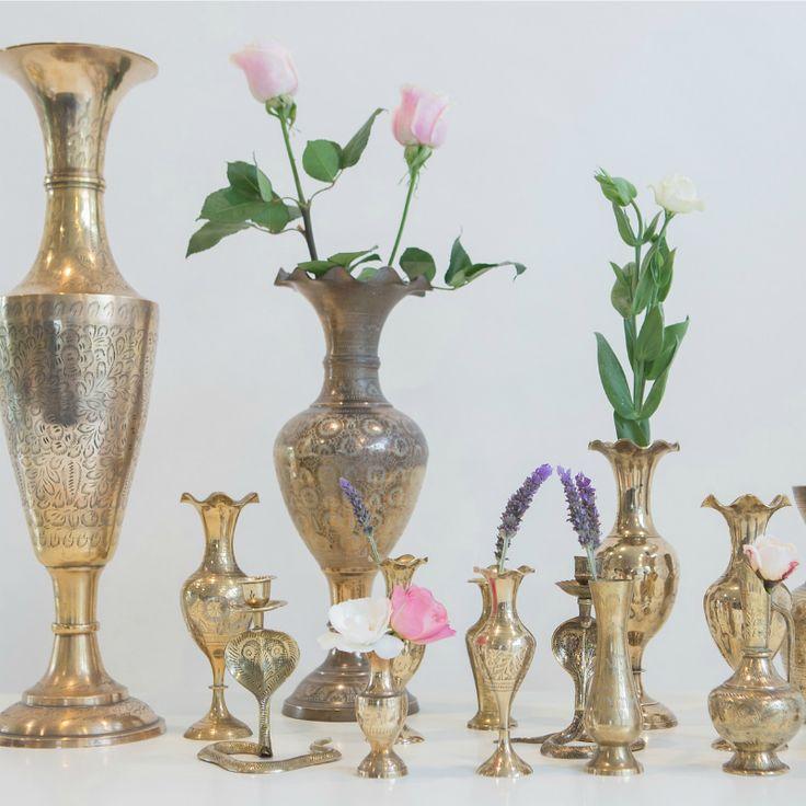 Brass Vases for Hire.  http://www.thewhiteweddingclub.com