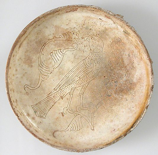 """Bowl with Bird of Prey, circa 11-13 AD. Byzantine. """"The bird's hooked beak signals that it is a bird of prey. It may be a falcon trained for the hunt. Falconry or hawking was enjoyed by the aristocracy, who generally hunted with trained predators. Practical manuals describing the breeding, training, and treatment of these highly prized birds are evidence of the sport's popularity."""""""