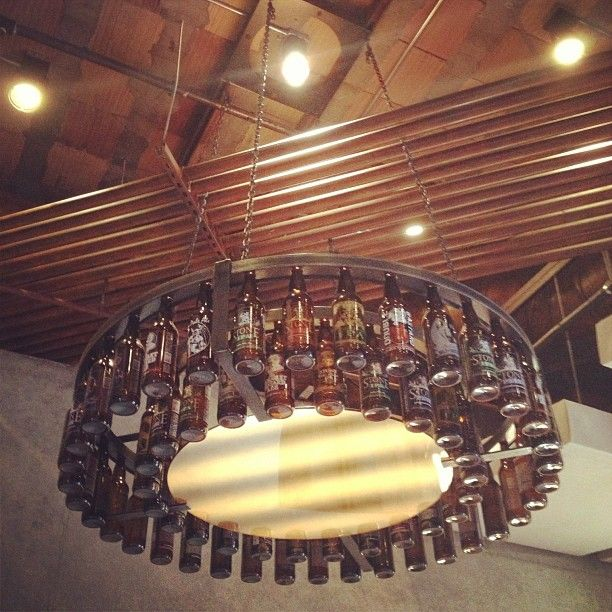 Beer bottle chandelier! May have to make this for my husband with the help of people to drink the beer. lol