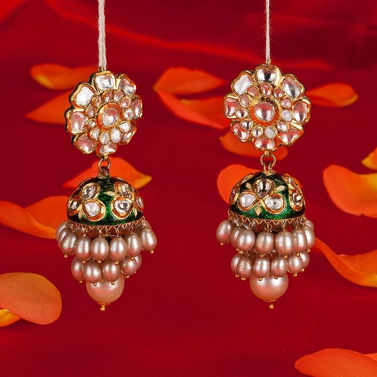Indian Wedding Jewelry - Polki Pearl Jhumkas | WedMeGood Flower shaped Polki Jhumkis, with Meenakari Work and Pearls. #wedmegood #jewellery
