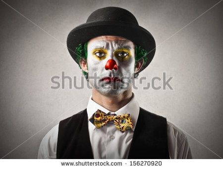portrait of sad clown with bowler hat and red nose - stock photo
