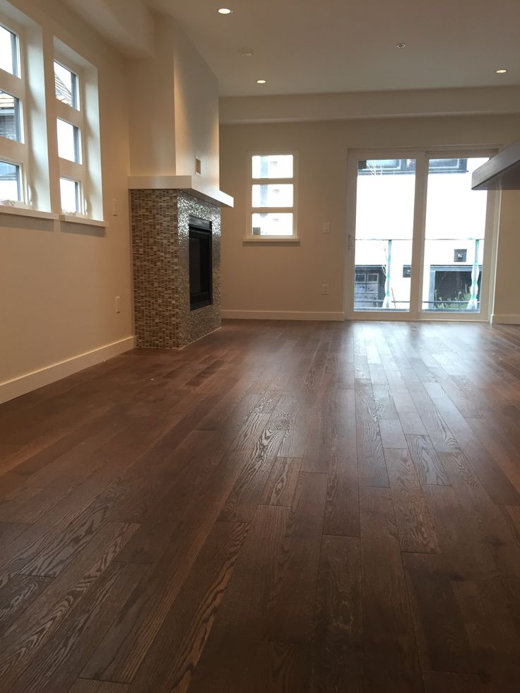 Beautiful living room featuring Lauzon's Sincero wire brushed hardwood flooring from the Authentik Series. This brown flooring features the exclusive air-purifying technology called Pure Genius technology. Project realized by Trasolini Chetner Construction. #interiordesign #hardwoodfloor #artfromnature