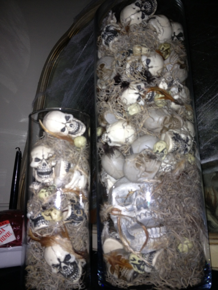 halloween centerpieces made with vases skulls moss feathers - Halloween Centerpieces Wedding