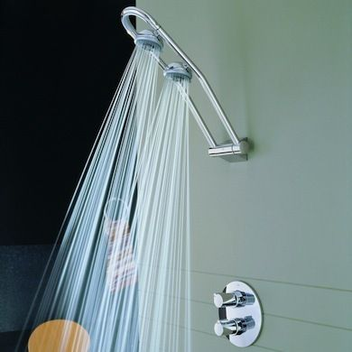 The GROHE Freehander is a unique, sculptural mounted fixture featuring two rotating shower heads that can also be locked into place.