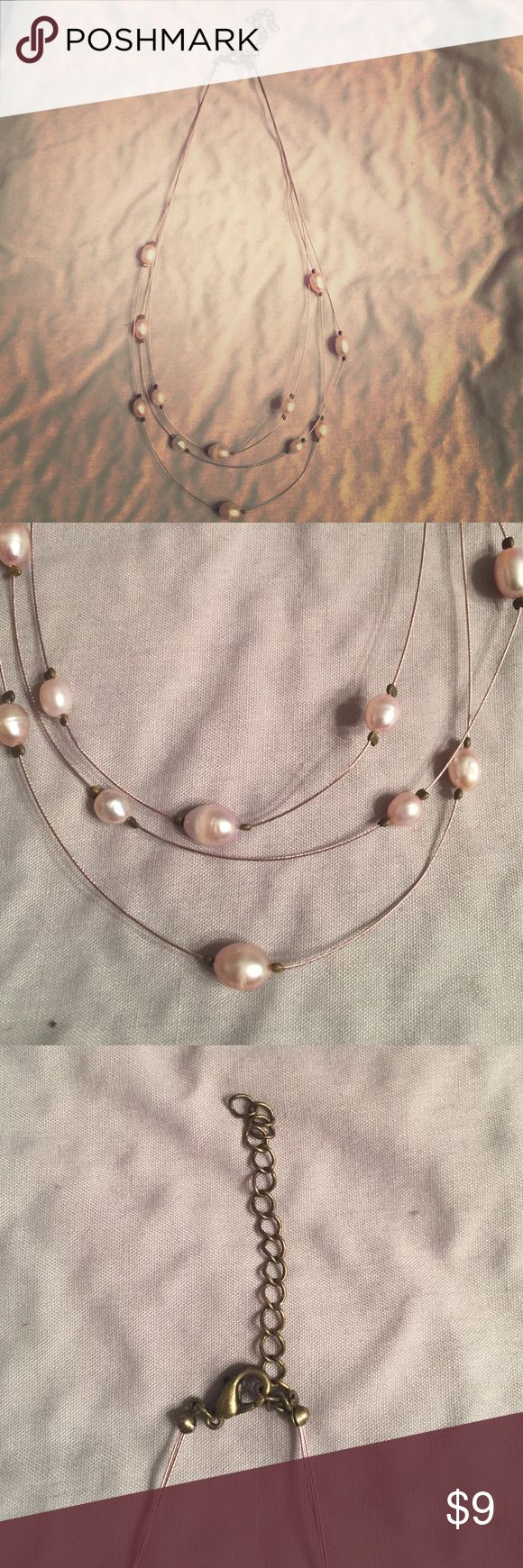 Pearl necklace Never been worn pearl layered necklace with pink wire like chain and adjustable chain hooks super cute to wear with plain outfit! boutique Jewelry Necklaces