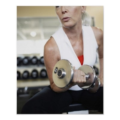 Option 5:    Woman Exercising With Weights at Gym Poster