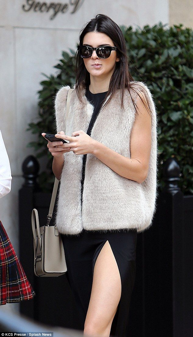 Keeping cosy:Avoiding the autumn chill, the reality star opted for a luxurious looking gilet, which perfectly complemented her low-heeled Chelsea boots.