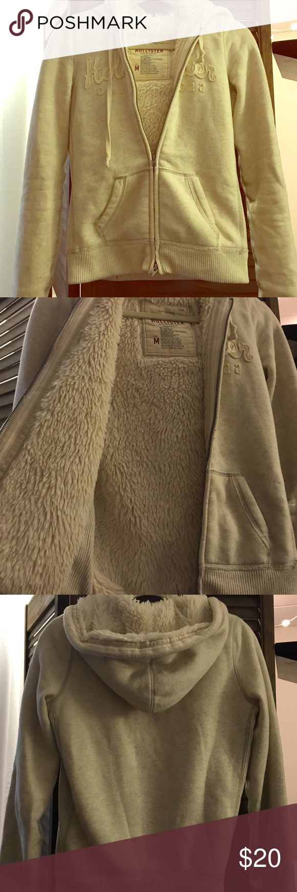 Hollister fur lined zip up hoodie Cream colored fur zip up. Last photo show small little brown spots, just from moving haven't worn more then a handle of times around the house to keep cozy Hollister Sweaters
