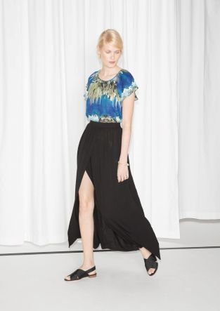 Pliable jersey overlaps gracefully at the front of this ankle-skimming skirt, showing a glimpse of your sun-kissed legs.