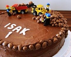 Chocolate cake with legos and cars