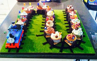 Thomas the Tank Engine cupcake train. could make some of the cupcakes 'coal' cars by crunching oreos on top of chocolate frosting.