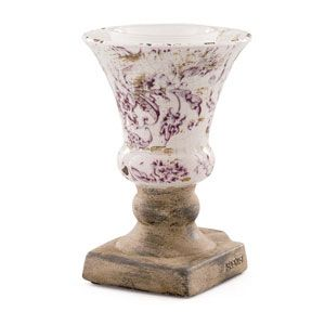 Inspired by a statuesque Grecian goblet complete with antiqued, weathered detailing Claret proves a little drama goes a long way.
