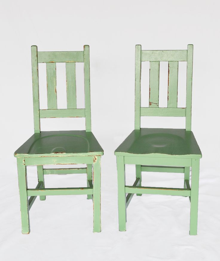 Low back old school chairs in green enamel: These old school chairs typically have two slats in the back, a solid seat, came in two height variants and were made from imported teak. #AntiqueShops #Johannesburg #SouthAfrica #Furniture #Chairs #Teak #SchoolChairs