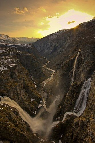 This reminds me of the area Kallan and Rune walk through in Chapters 30 to 40 :) Vøringsfossen fjord in Hardanger (this is a county), entrance to Bergen and Stavanger (which are port towns) in Norway.