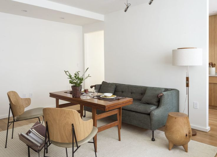 Workstead-designed NYC living room with BDDW sofa, Penguin Chairs, and Kai Kirstiansen teak Elevator Table, Matthew Williams photo