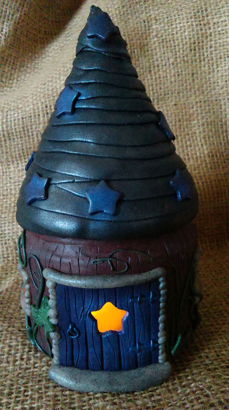 Polymer Clay Mystical tower night light, Made using FIMO and a glass jar, contains a battery operated flickering candle.
