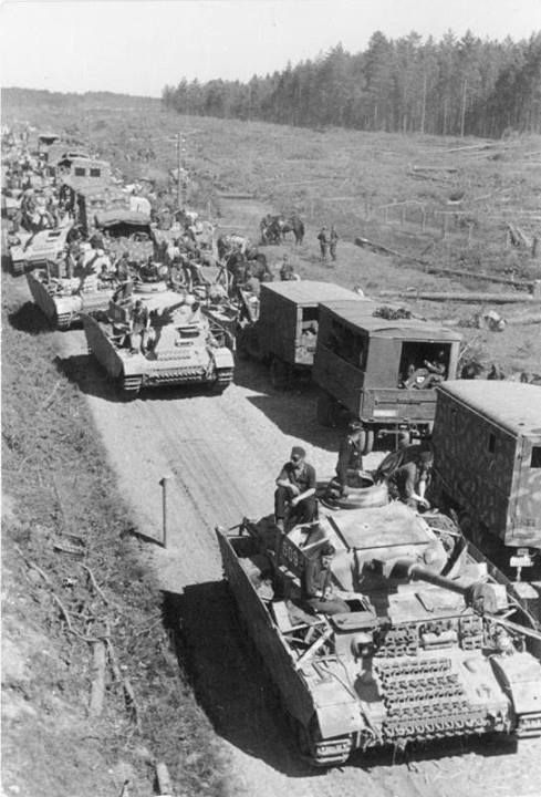 Panzer IV column on the rollbahn during battle of Kursk. Later model tanks with single piece commanders hatch and side skirt armor.
